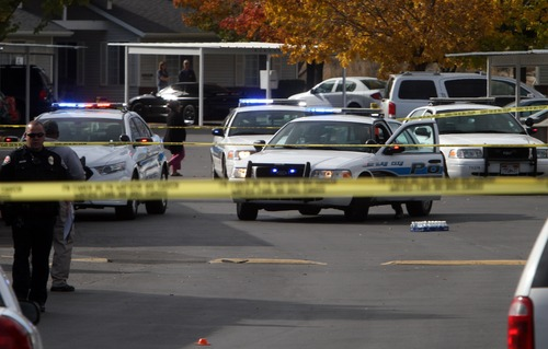 Rick Egan  | The Salt Lake Tribune   Dozens of West Valley police cars fill the parking lot of the Lexington Park apartments in West Valley City, after a fatal  shooting at the complex, Friday, November 2, 2012.