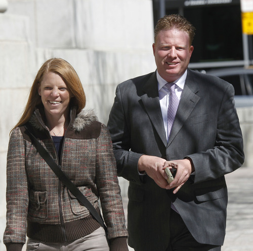 Al Hartmann  |  The Salt Lake Tribune An assistant U.S. attorney alleged Thursday that Jeremy Johnson or others acting on his behalf, including Johnson's wife, Sharla (seen with him in April), were continuing to post information in defiance of a court order.