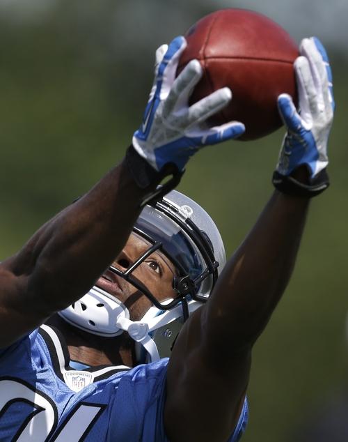 Detroit Lions wide receiver Ryan Broyles keeps his eye on a catch during an NFL football minicamp practice in Allen Park, Mich., Thursday, June 13, 2013. (AP Photo/Paul Sancya)