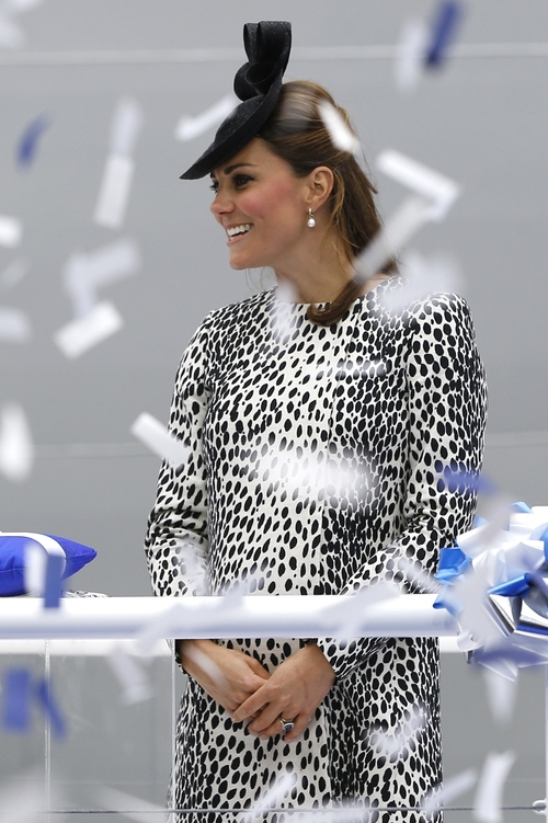 Britain's Kate, the Duchess of Cambridge smiles as ticker tape falls during a naming ceremony for the 'Royal Princess' cruise ship in Southampton, England, Thursday, June 13, 2013. (AP Photo/Kirsty Wigglesworth)