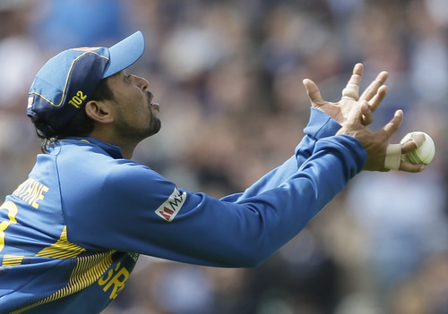 Sri Lanka' Tilakaratne Dilshan fails to catch a shot by England's Joe Root during their ICC Champions Trophy cricket match at the Oval cricket ground in London, Thursday, June 13, 2013. (AP Photo/Alastair Grant)