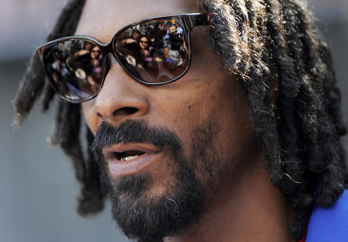 """Snoop Lion, formerly known as Snoop Dogg, a cast member in the animated 3D film """"Turbo,"""" is interviewed at a party for the film at Nokia Plaza on Wednesday, June 12, 2013 in Los Angeles. (Photo by Chris Pizzello/Invision/AP)"""