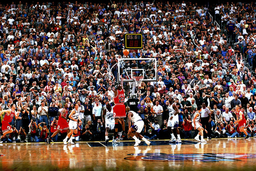 Michael Jordan rises up to take the championship-clinching shot against the Jazz in Game 6 of the 1998 NBA Finals. Fifteen years later, Jazz fans sitting in the stands that night and captured in the iconic photo still haven't forgotten the moment. (Photo by Fernando Medina/NBAE via Getty Images),
