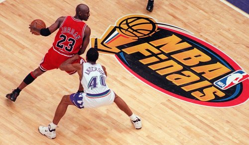 Utah Jazz's Shandon Anderson tries to block Chicago Bulls' Michael Jordan in the second half of Game 6 of the NBA Finals in Salt Lake City, Sunday, June 14, 1998. (AP Photo/Mark J. Terrill)