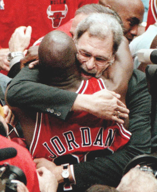Chicago Bulls coach Phil Jackson and Michael Jordan embrace after the Bulls won their 6th NBA championship with an 87-86 win over the Utah Jazz in Game 6 on Sunday, June 14, 1998, at the Delta Center in Salt Lake City. (AP Photo/Chicago Tribune, Nuccio DiNuzzio)