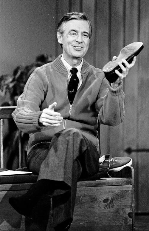 """Fred Rogers, here rehearsing the opening of his PBS show """"Mister Rogers' Neighborhood"""" in 1989, is still revered in Pittsburgh and by educators, social workers, psychologists and more for the influence he had on generations of children. (AP Photo/Gene J. Puskar)"""