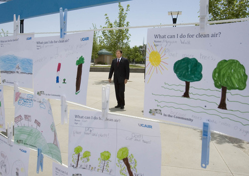 Paul Fraughton  |  The Salt Lake Tribune As he walks toward the Fairbourne Station Plaza in West Valley City  for a UCAIR event Gov. Gary Herbert is framed by children's art showing examples of what can be done for clean air. Tuesday, June 11, 2013