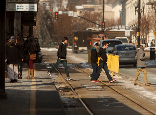 Trent Nelson  |  The Salt Lake Tribune Pedestrians crossing the TRAX lines outside of the crosswalk are easy to spot at the City Center station Thursday January 3, 2013 in Salt Lake City.