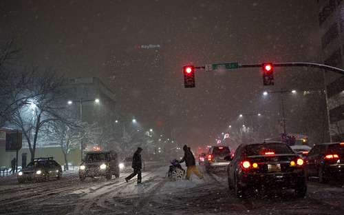 Lennie Mahler  |  The Salt Lake Tribune Pedestrians cross State Street at 200 S through traffic backed up and clogging the intersection due to snow-covered roads, Thurdsay, Jan. 10, 2013.