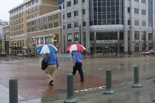 Paul Fraughton  |   Salt Lake Tribune Pedestrians make their way across South Temple  in a spring rainstorm.   Friday, April 5, 2013