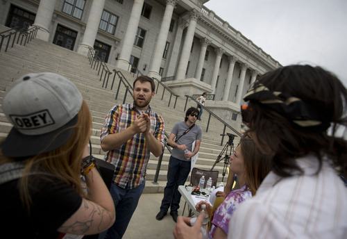 Lennie Mahler  |  The Salt Lake Tribune Dan Garfield speaks with protesters about encryption software and other ways to protect personal data. About 25 turned out for a rally at the Utah State Capitol on Wednesday to oppose PRISM, an NSA program which stores citizens' personal phone records and internet usage metadata.