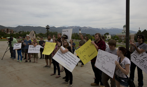 Lennie Mahler  |  The Salt Lake Tribune Protesters gather at the Utah State Capitol on Wednesday in opposition to the PRISM program, which tracks and stores citizens' personal phone records and internet usage metadata.