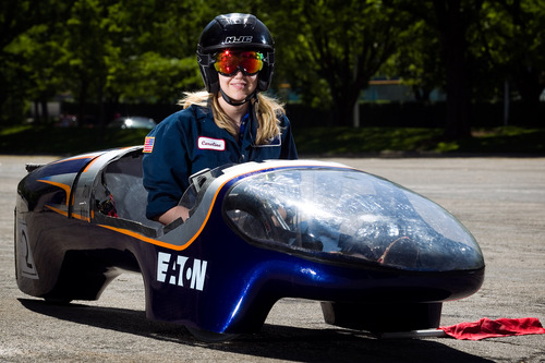 In this Tuesday, June 12, 2013 photo, BYU student Caroline Sorensen sits for a portrait in her team's supermileage vehicle during a demonstration at LaVell Edwards Stadium in Provo, Utah. (AP Photo/The Daily Herald, Mark Johnston)