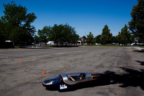 In this Tuesday, June 12, 2013 photo, BYU student Caroline Sorensen drives her team's supermileage vehicle during a demonstration at LaVell Edwards Stadium in Provo, Utah. (AP Photo/The Daily Herald, Mark Johnston)