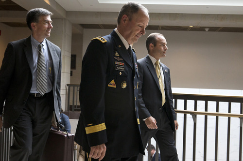 Gen. Keith Alexander, Director of the National Security Agency, center, leaves a Senate Intelligence Committee meeting regarding NSA programs, in Washington, Thursday, June 13, 2013. (AP Photo/Jacquelyn Martin)