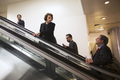Sen. Dianne Feinstein, D-Calif., second from left, chair of the Senate Intelligence Committee, turns to answer a question as she leaves a meeting regarding National Security Agency programs, on Capitol Hill in Washington, Thursday, June 13, 2013. (AP Photo/Jacquelyn Martin)