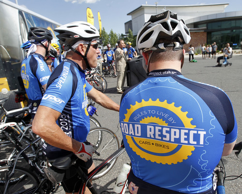 """Al Hartmann     The Salt Lake Tribune A group of """"elite bicyclists"""" from UDOT, the Highway Patrol and other law enforcement agencies gather together at UTA's Salt Lake Central station Thursday June 13 to launch a statewide tour to try to improve road safety for bicyclists."""