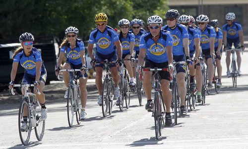 """Al Hartmann     The Salt Lake Tribune A group of """"elite bicyclists"""" from UDOT, the Highway Patrol and other law enforcement agencies ride together to UTA's Salt Lake Central station on Thursday to launch a statewide tour to try to improve road safety for bicyclists."""