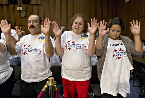 Associated Press |  File photo Immigration activists gather to pray on Capitol Hill in Washington, D.C., late last month before the Senate Judiciary Committee began work on a landmark immigration bill to secure the border and offer citizenship to millions.