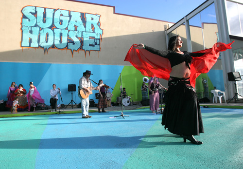 Rick Egan  | The Salt Lake Tribune   Juana Ghani performs at the grand opening of the Sugarmont Plaza, a temporary plaza in the parking lot of the old Deseret Industries parking lot. Friday, June 14, 2013.