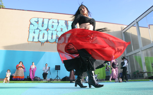 Rick Egan  |  The Salt Lake Tribune Juana Ghani performs on Friday at the grand opening of the Sugarmont Plaza, a temporary plaza in the parking lot of the old Deseret Industries parking lot.