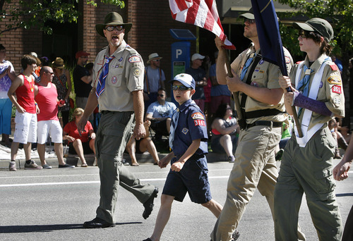 Scott Sommerdorf  |  The Salt Lake Tribune Former Scoutmaster Dave McGrath, left, and current leader Neil Whitaker, holding the American flag, lead a small contingent of Boy Scouts and Cub Scouts in the color guard at the front of the Utah Pride Parade in downtown Salt Lake City on June 2.