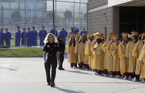Al Hartmann  |  The Salt Lake Tribune A record-high 360 men and women inmates line up for high school graduation procession at the Draper prison Wednesday June 12 to celebrate an important milestone on their paths toward returning to the community as law-abiding citizens. Another 140 inmates will likewise walk in a commencement ceremony at the Central Utah Correctional Facility in Gunnison on June 19.