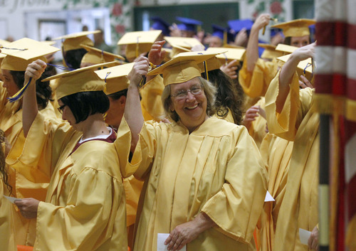 Al Hartmann  |  The Salt Lake Tribune Women inmates move tassles on their mortarboards upon receiving their high school diplomas at the Utah State Prison in Draper Wednesday June 11. A record-high 360 men and women inmates graduated with high school diplomas and celebrated an important milestone on their paths toward returning to the community as law-abiding citizens. Another 140 inmates will likewise walk in a commencement ceremony at the Central Utah Correctional Facility in Gunnison on June 19.