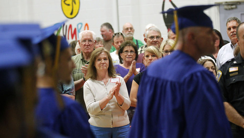 Al Hartmann  |  The Salt Lake Tribune Friends and family applaud as inmates leave the auditorium with their high school diplomas at the Utah State Prison in Draper Wednesday June 11. A record-high 360 men and women inmates graduated with high school diplomas and celebrated an important milestone on their paths toward returning to the community as law-abiding citizens. Another 140 inmates will likewise walk in a commencement ceremony at the Central Utah Correctional Facility in Gunnison on June 19.