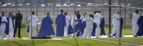 Al Hartmann  |  The Salt Lake Tribune Inmates remove their gowns returning to their white prison clothing underneath after high school graduation at the Utah State Prison in Draper Wednesday June 11. A record-high 360 men and women inmates graduated with high school diplomas and celebrated an important milestone on their paths toward returning to the community as law-abiding citizens. Another 140 inmates will likewise walk in a commencement ceremony at the Central Utah Correctional Facility in Gunnison on June 19.