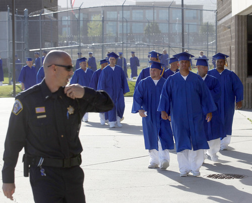 Al Hartmann  |  The Salt Lake Tribune A record-high 360 men and women inmates line up for their high school graduation procession at the Draper prison in June 2013 to celebrate an important milestone on their paths toward returning to the community as law-abiding citizens.