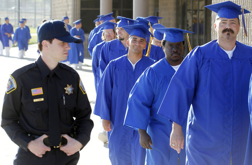 Al Hartmann  |  The Salt Lake Tribune A record-high 360 men and women inmates line up for their high school graduation procession at the Draper prison Wednesday June 12 to celebrate an important milestone on their paths toward returning to the community as law-abiding citizens. Another 140 inmates will likewise walk in a commencement ceremony at the Central Utah Correctional Facility in Gunnison on June 19.