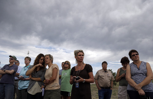 Evacuess and fire officials listen to a news briefing on the Black Forest Fire in Colorado Springs, Colo., Friday, June 14, 2013. Little more than 36 hours after it started in the Black Forest area northeast of Colorado Springs, the blaze surpassed last June's Waldo Canyon fire as the most destructive in state history. (AP Photo/Marcio Jose Sanchez)
