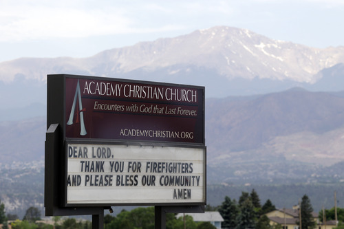 A sign at the Academy Christian Church thanks firefighters for their efforts in the outskirts of the Black Forest Fire in Colorado Springs, Colo., Friday, June 14,  2013. Little more than 36 hours after it started in the Black Forest area northeast of Colorado Springs, the blaze surpassed last June's Waldo Canyon fire as the most destructive in state history. (AP Photo/Marcio Jose Sanchez)