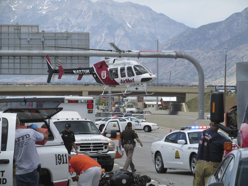 A man was taken taken to the hospital via helicopter Saturday after he was hit from behind by another car on Interstate 15 near Spanish Fork. The crash occurred in a traffic buildup caused by the rollover of a semi truck about a mile ahead. Courtesy Utah Highway Patrol