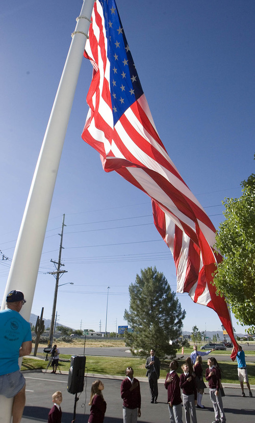 Paul Fraughton  |  The Salt Lake Tribune To commemorate Flag Day, Colonial Flag in Sandy raised its 30-by-60 American flag after a brief ceremony. The Challenger School's corporate headquarters, across the street from Colonial, raised an identical flag at the same time.