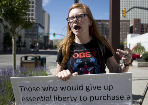 Lennie Mahler  |  The Salt Lake Tribune Macey Booth speaks out against PRISM, an NSA program which gathers and stores phone and internet data without user permission. The protest attracted six people in front of the Wallace Bennett Federal Building in Salt Lake City, Friday, June 14, 2013.
