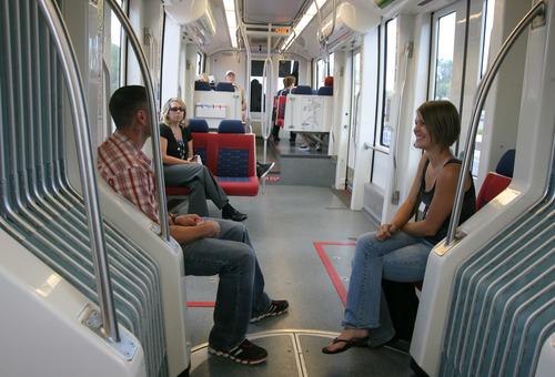 Rick Egan    The Salt Lake Tribune   Trax passengers ride the train to the Salt Lake International Airport on the green line, Thursday, June 13, 2013.