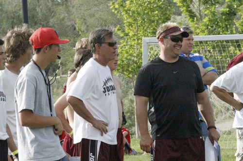 | Jon Clifford Coaches Mark Battaglia, left, and Mike Franz coach the Jordan ninth-grade team at the Utah Youth 7 on 7 passing championships on Friday, June 7 at Galena Park in Draper.