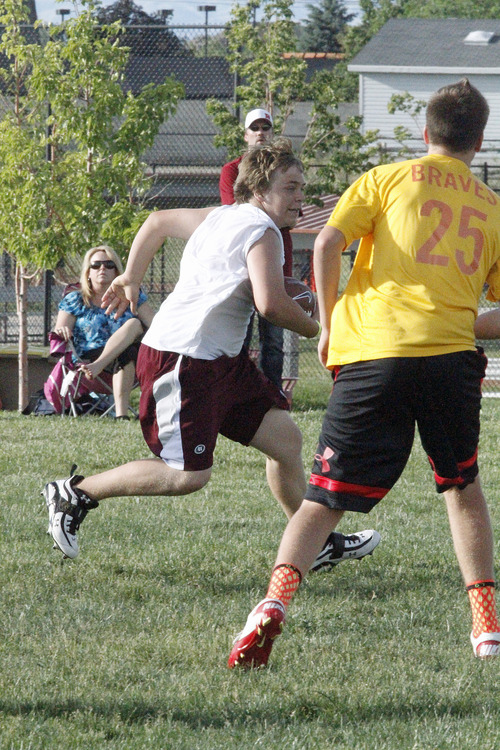 | Jon Clifford Jordan freshman Alec Kener runs after a catch against Bountiful during the Utah Youth 7 on 7 passing championships on Friday, June 7 at Galena Park in Draper.