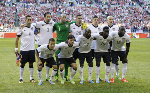 USA's national soccer team poses for the traditional team photo prior to a World Cup qualifier soccer match against Panama, Tuesday, June 11, 2013, in Seattle. Pictured are (front row, left to right) Fabian Johnson, Brad Evans, DaMarcus Beasley, Eddie Johnson, and Jozy Altidore. Back row, left to right, are Clint Dempsey, Omar Gonzalez, goalkeeper Tim Howard, Geoff Cameron, Matt Besler, and Michael Bradley. (AP Photo/Ted S. Warren)
