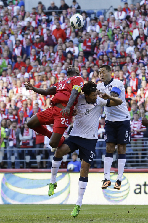 USA's Clint Dempsey, right, Omar Gonzalez, center, and Panama's Felipe Baloy, left, jump for a header during a World Cup qualifier soccer match, Tuesday, June 11, 2013, in Seattle. USA defeated Panama, 2-0. (AP Photo/Ted S. Warren)