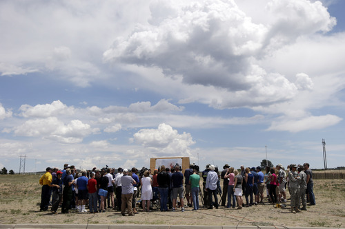 Residents and press gather for an update on the progress of the Black Forest Fire in Colorado Springs, Colo., Sunday, June 16, 2013. (AP Photo/Marcio Jose Sanchez)