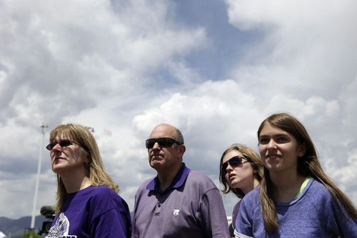 The Meier family, from left Donna, Lee, Megan and Abbey from Black Forest, Colo.,  listen to a briefing on the progress of the Black Forest Fire in Colorado Springs, Colo., Sunday, June 16, 2013.  Firefighters worked to get more people evacuated by Colorado's most destructive wildfire back home Sunday by digging up and extinguishing hot spots to protect homes still standing near Colorado Springs. (AP Photo/Marcio Jose Sanchez)