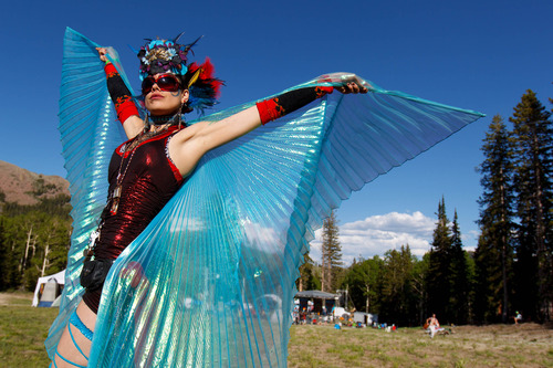 Trent Nelson  |  The Salt Lake Tribune Miss Lissa Meow dances as The Heavy Guilt performs at the Roots of the Rocks Music Festival at the Eagle Point Ski Resort Saturday, June 15, 2013 east of Beaver.