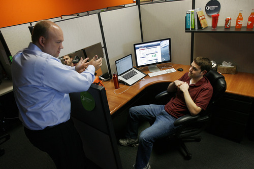 Scott Sommerdorf      The Salt Lake Tribune Nick Stice, VP of engineering, left, has an impromptu meeting with User Interface Engineer Cameron Nokes in the OrangeSoda offices in American Fork, Wednesday, June 5, 2013. Thirty-five percent of all jobs created in Utah since 2010 have been created between 10600 South in Salt Lake County and Provo/Orem. Most have been high technology jobs like the ones at OrangeSoda which has about 200 employees. The company helps clients with online marketing. It employs people in all sorts of occupations, including software engineers, web designers and sales people.