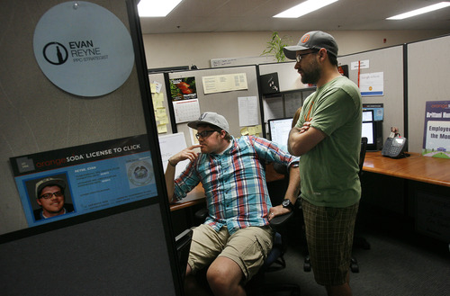 Scott Sommerdorf      The Salt Lake Tribune Evan Reyne, left, a PPC Strategist at OrangeSoda in American Fork has a meeting at his desk, Wednesday, June 5, 2013.  Thirty-five percent of all jobs created in Utah since 2010 have been created between 10600 South in Salt Lake County and Provo/Orem. Most have been high technology jobs like the ones at OrangeSoda which has about 200 employees.