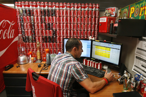 Scott Sommerdorf      The Salt Lake Tribune Chad Taylor, a partner development analyst at OrangeSoda in American Fork has decorated his desk with Coca Cola items, Wednesday, June 5, 2013. Thirty-five percent of all jobs created in Utah since 2010 have been created between 10600 South in Salt Lake County and Provo/Orem. Most have been high technology jobs like the ones at OrangeSoda which has about 200 employees.