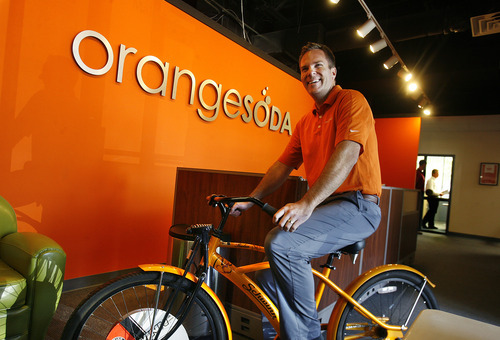 Scott Sommerdorf      The Salt Lake Tribune One of the original founders of OrangeSoda, Derek Miner, poses on one of the orange bikes employees sometimes use at the company to get around the office, Wednesday, June 5, 2013. Thirty-five percent of all jobs created in Utah since 2010 have been created between 10600 South in Salt Lake County and Provo/Orem. Most have been high technology jobs like the ones at OrangeSoda which has about 200 employees.