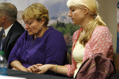 Francisco Kjolseth  |  The Salt Lake Tribune Tara Evans, left, is comforted by her daughter Karen Evans during a press conference at the McKay-Dee Hospital Center in Ogden on Monday, June 17, 2013, during an update on the condition of her husband James Evans who was shot in the head during church services on Sunday.